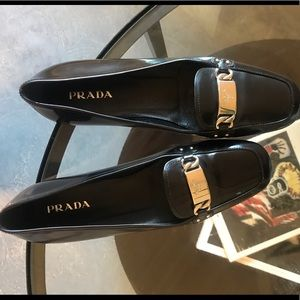 BLACK PRADA LOAFERS WITH SILVER DETAIL